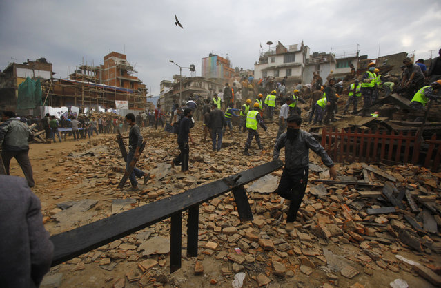 Rescue workers remove debris at Durbar Square after an earthquake in Kathmandu, Nepal, Saturday, April 25, 2015. (Photo by Niranjan Shrestha/AP Photo)