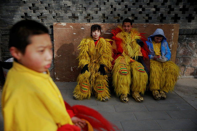 Performers in lion dance costumes wait for their turn to go on stage at Longtan park as the Chinese Lunar New Year, which welcomes the Year of the Rooster, is celebrated in Beijing, China January 29, 2017. (Photo by Damir Sagolj/Reuters)