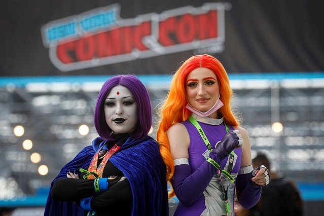 A women in costume pose together at the 2021 New York Comic Con,at the Jacob Javits Convention Center in Manhattan in New York City, New York, U.S., October 7, 2021. (Photo by Brendan McDermid/Reuters)