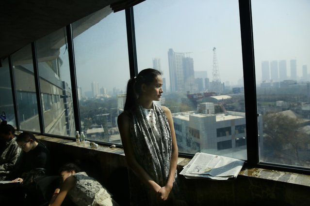 In this  January 30, 2017 photo, Anjali Lama, a transgender model from Nepal, looks out of a window of a hotel during a trial event for Lakme Fashion week in Mumbai, India. (Photo by Rafiq Maqbool/AP Photo)