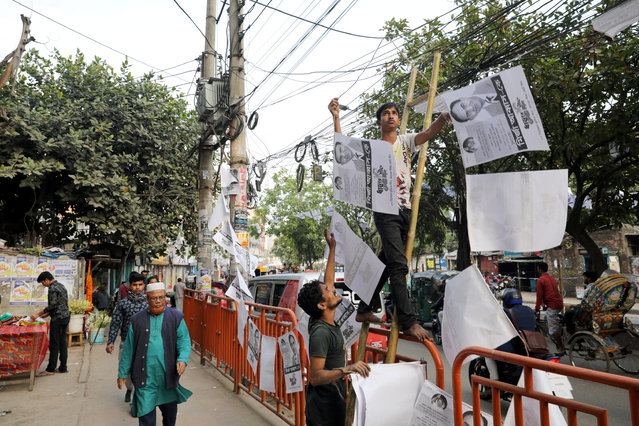 People hang posters of the Bangladesh Nationalist Party (BNP) on the street, ahead of the 11th general election in Dhaka, Bangladesh, December 22, 2018. (Photo by Mohammad Ponir Hossain/Reuters)