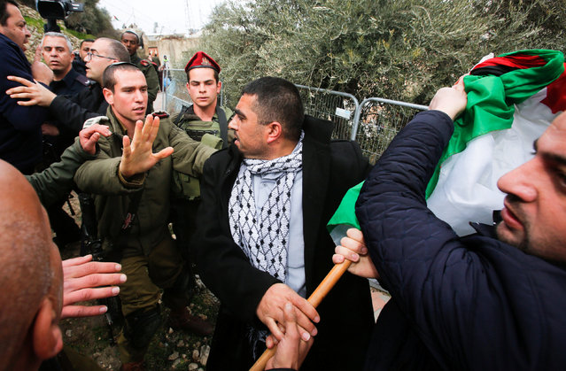 A Palestinian protester argues with an Israeli army officer during a protest calling for reopening a closed street in the West Bank city of Hebron February 9, 2017. (Photo by Mussa Qawasma/Reuters)