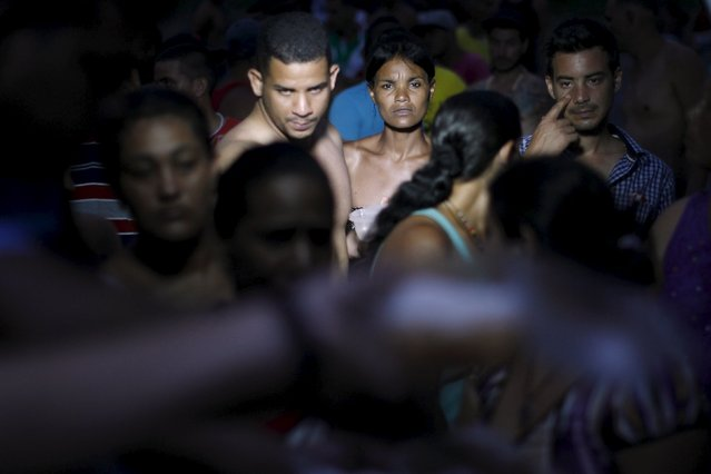 Cuban migrants queue for donated food at a provisional shelter in Paso Conoa, at the border with Costa Rica March 20, 2016. (Photo by Carlos Jasso/Reuters)