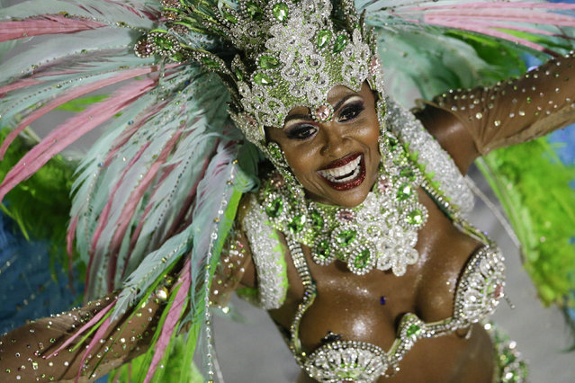 A performer from the Mangueira samba school parades during carnival celebrations at the Sambadrome in Rio de Janeiro, Brazil, Monday, March 3, 2014. (Photo by Felipe Dana/AP Photo)