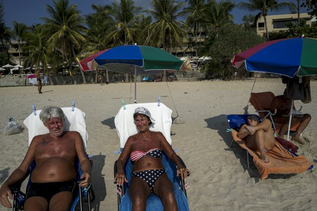 Tourists sunbath on Kata beach in Phuket, Thailand March 17, 2016. (Photo by Athit Perawongmetha/Reuters)