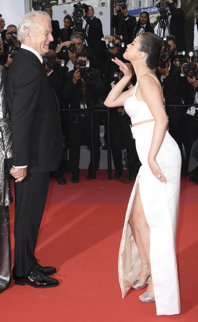 "Actress Selena Gomez, right, shares a joke with actor Bill Murray upon arrival at the opening ceremony and the premiere of the film ""The Dead Don't Die"" at the 72nd international film festival, Cannes, southern France, Tuesday, May 14, 2019. (Photo by Arthur Mola/Invision/AP Photo)"