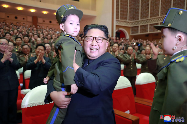 "In this June 2, 2019, photo provided on Monday, June 3, 2019, by the North Korean government, North Korean leader Kim Jong Un, center, holds a boy in his arm during a musical performance by the wives of Korean People's Army officers in North Korea. A senior North Korean official who had been reported as purged over the failed nuclear summit with Washington was shown in state media enjoying a concert alongside leader Kim. Independent journalists were not given access to cover the event depicted in this image distributed by the North Korean government. The content of this image is as provided and cannot be independently verified. Korean language watermark on image as provided by source reads: ""KCNA"" which is the abbreviation for Korean Central News Agency. (Photo by Korean Central News Agency/Korea News Service via AP Photo)"