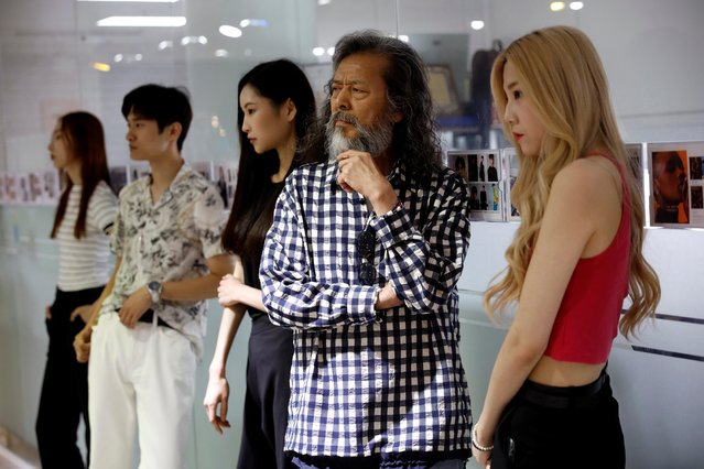 A South Korean senior model Kim Chil-doo, 65-years-old, attends a practice session in Seoul, South Korea, June 12, 2019. Seniors have flocked to modeling schools on the back of Kim's success. Others have become YouTube stars or signed up to teach Korean to K-pop fans overseas. (Photo by Kim Hong-Ji/Reuters)