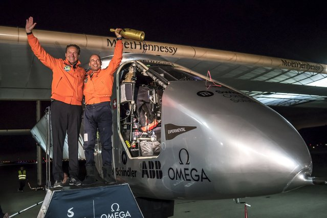 Swiss pilot Bertrand Piccard (R) reacts together with alternate pilot Andre Borschberg after landing Solar Impulse 2, a solar-powered plane, on Moffett Airfield in Mountain View, California, U.S. April 23, 2016, following a 62-hour flight from Hawaii. (Photo by Jean Revillard/Reuters/Solar Impulse)
