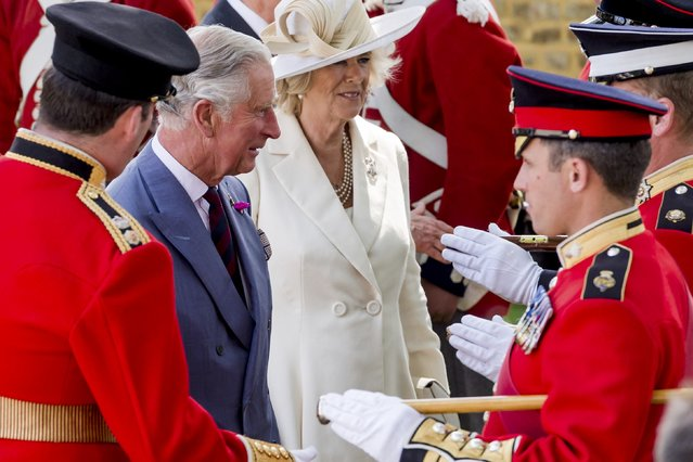 Britain's Prince Charles and Camilla, the Duchess of Cornwall, speak with the troops during a ceremony for the opening of the Hougoumont farm as part of the bicentennial celebrations for the Battle of Waterloo, near Waterloo, Belgium June 17, 2015. The commemorations for the 200th anniversary of the Battle of Waterloo will take place in Belgium on June 19 and 20. REUTERS/Geert Vanden Wijngaert/Pool