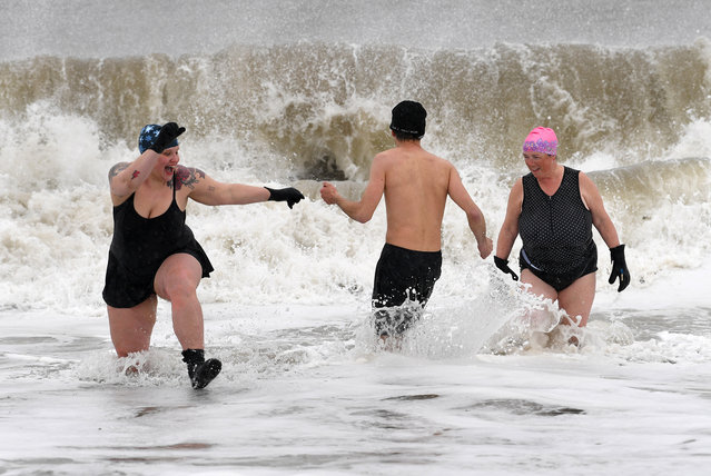 Despite the high winds and fright temperatures, about 1/2 dozen brave members of the Coney Island Polar Bear Club took a dip in the Atlantic Ocean at March 14, 2017, just of Stillwell avenue in Coney Island beach in Brooklyn NYC. Snow began blanketing northeastern United States on Tuesday as a winter storm packing blizzard conditions rolled into the region, prompting public officials to ask people to stay home while airlines grounded flights and schools canceled classes. The National Weather Service issued blizzard warnings for parts of eight states including New York, Pennsylvania, New Jersey and Connecticut, with forecasts calling for up to 2 feet of snow by early Wednesday, with temperatures 15 to 30 degrees below normal for this time of year. (Photo by Paul Martinka)