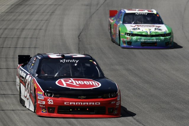 Austin Dillon (33) leads during the NASCAR Xfinity series auto race at Chicagoland Speedway, Sunday, June 21, 2015, in Joliet, Ill. (AP Photo/Nam Y. Huh)