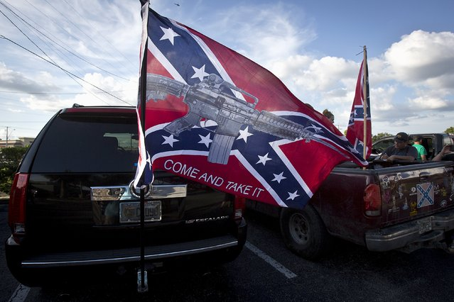 "A flag on the back of a SUV flies before for a ""Ride for Pride"" event to show support for the Confederate flag in Brandon, Hillsborough County, June 26, 2015. (Photo by Carlo Allegri/Reuters)"