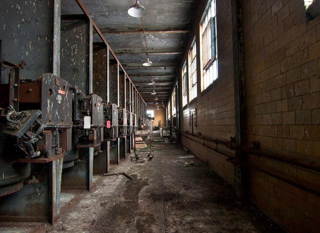 A row of generators inside the abandoned Rayon Plant of Painesville, Ohio. (Photo by Jonny Joo/Barcroft Media)
