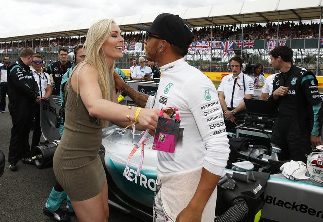 Formula One, British Grand Prix 2015 – Silverstone, England on July 5, 2015: Skier Lindsey Vonn kisses Mercedes' Lewis Hamilton before the race. (Photo by Phil Noble/Reuters)