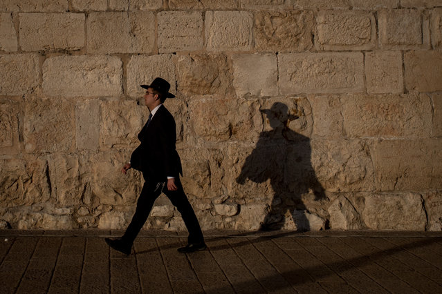A jewish man walks along the wall of the  Old City on March 31, 2018 in Jerusalem, Israel. Thousands of tourists and pilgrims have descended on the holy city of Jerusalem to attend activities to mark Christian Holy week from March 25 to April 2. (Photo by Chris McGrath/Getty Images)