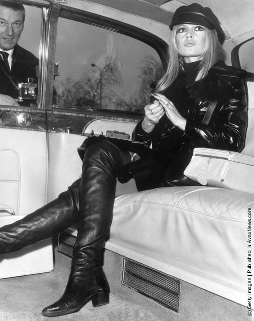 1968: French actress Brigitte Bardot relaxes in the back of a limousine upon her arrival at London's Heathrow Airport