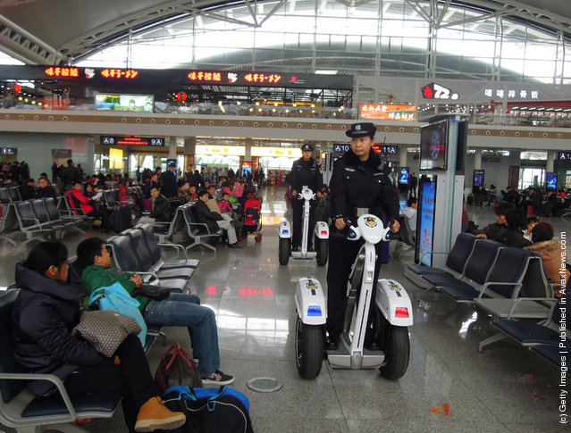 Police women ride Segways as they patrol at Guangzhou South Railway Station in Guangzhou, China
