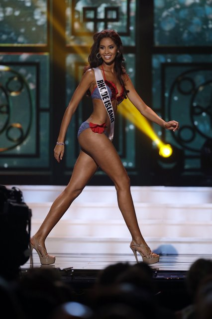 Miss Rhode Island, Anea Garcia, competes in the bathing suit competition during the preliminary round of the 2015 Miss USA Pageant in Baton Rouge, La., Wednesday, July 8, 2015. (Photo by Gerald Herbert/AP Photo)