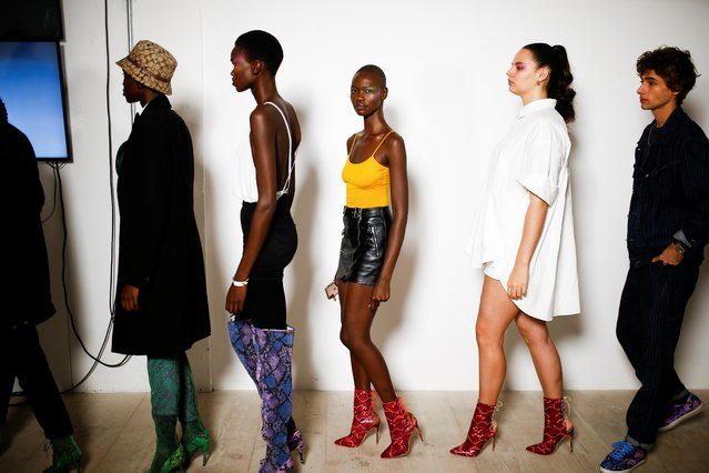 Models prepare backstage of the Mark Fast catwalk show during London Fashion Week in London, Britain, September 13, 2019. (Photo by Henry Nicholls/Reuters)