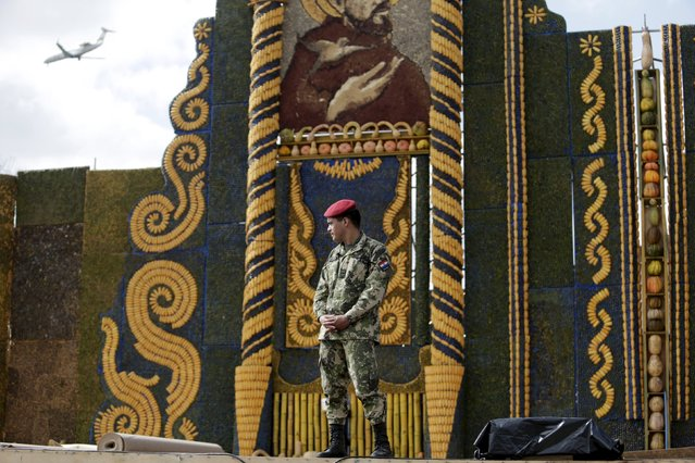 A soldier guards an altar, made of corn and pumpkins, where Pope Francis will give the main mass on July 12 during his visit to Paraguay, July 9, 2015. (Photo by Jorge Adorno/Reuters)