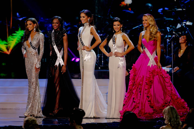 Miss Nevada Brittany McGowan, Miss Maryland Mame Adjei, Miss Rhode Island Anea Garcia, Miss Texas Ylianna Guerra and Miss Oklahoma Olivia Jordan competes during the 2015 Miss USA pageant in Baton Rouge, La., Sunday, July 12, 2015. (Photo by Derick E. Hingle/AP Photo)