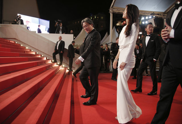 Director Park Chan-Wook, centre and actress Kim Tae-Ri pose for photographers upon arrival at the screening of the film The Handmaiden at the 69th international film festival, Cannes, southern France, Saturday, May 14, 2016. (Photo by Thibault Camus/AP Photo)