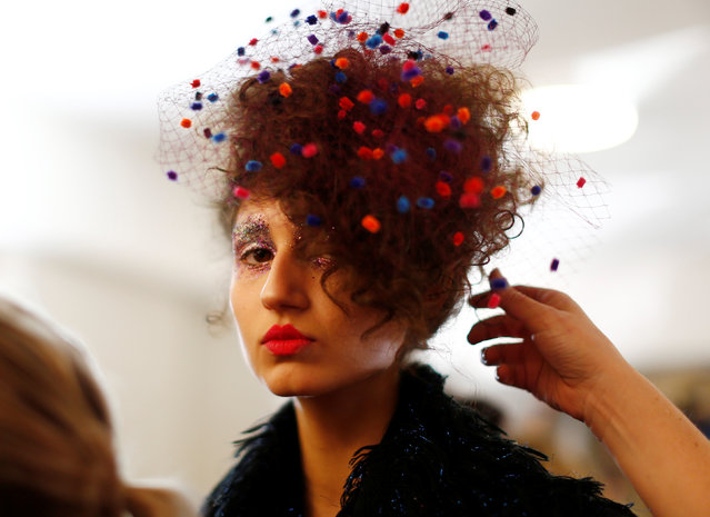 A model has her headwear adjusted backstage before a fashion show for the label Romance Was Born on the waterfront of Sydney Harbour during Australian Fashion Week, Sydney, Australia May 18, 2016. (Photo by Jason Reed/Reuters)