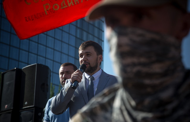 """Denis Pushilin, leader of the Donetsk People's Republic, fired up the crowd with news that the self-proclaimed republic had forged a union with neighboring Luhansk People's Republic, on May 24, 2014. Sunday's upcoming election in Ukraine has not only exposed the divide between east and west, but between old and young. """"These are just the first steps toward the reunion of the Russian people!"""" (Photo by Evelyn Hockstein/The Washington Post)"""