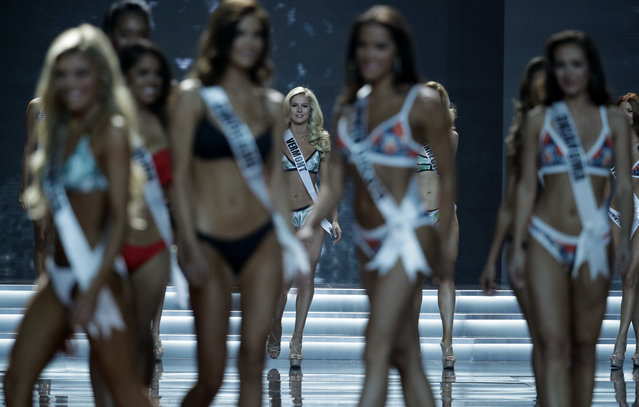 Miss Vermont USA Madison Cota, center, walks on stage with other contestants during the Miss USA contest Sunday, May 14, 2017, in Las Vegas. (Photo by John Locher/AP Photo)