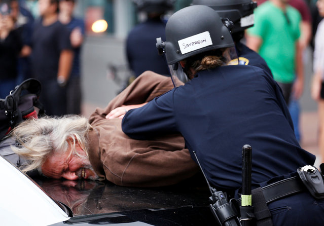 A man is arrested during a demonstration against Republican U.S. presidential candidate Donald Trump outside his campaign event in San Diego, California , U.S. May 27, 2016. (Photo by Jonathan Alcorn/Reuters)