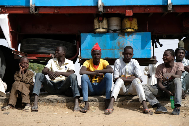 Young men and boys wait by a truck in the Muna Garage area on the outskirts of Maiduguri, Nigeria February 16, 2017. (Photo by Paul Carsten/Reuters)