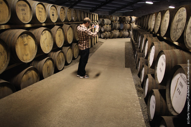 Tourists pay a visit to  Edradour distillery on March 26, 2012 in Pitlochry, United Kingdom