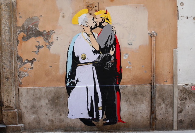 "A mural signed by ""TV Boy"" and depicting Pope Francis and U.S. President Donald Trump kissing, is seen on a wall in downtown Rome, Italy May 11, 2017. (Photo by Tony Gentile/Reuters)"