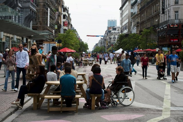 People are seen at the pedestrian area in Brussels, Belgium, August 1, 2015. Part of Brussels city centre was closed permanently to traffic on June 29, 2015, creating Europe's second largest urban pedestrian area after Venice in what was one of the city's busiest boulevards. (Photo by Eric Vidal/Reuters)