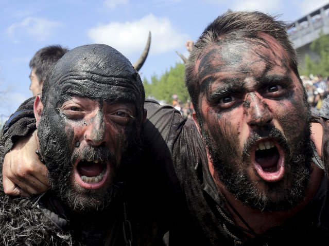 Men dressed up as Vikings shout during the annual Viking festival of Catoira in north-western Spain August 2, 2015. (Photo by Miguel Vidal/Reuters)