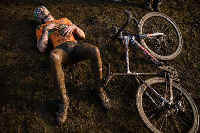 A rider recovers after competing in the Junior Men race of the British Cycling National Cyclo-Cross Championships at Shrewsbury Sports Village on January 12, 2020 in Shrewsbury, Central England. (Photo by Oli Scarff/AFP Photo)