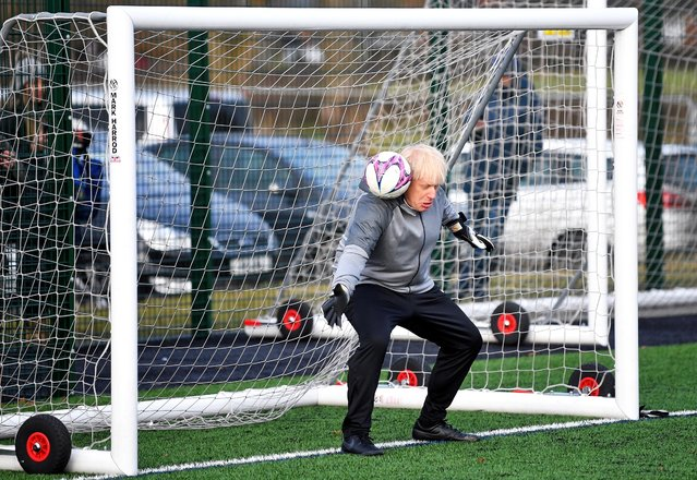 Britain's Prime Minister Boris Johnson attends a warm up before the Hazel Grove United JFC vs Poynton Juniors girls soccer match, as he campaigns in Cheadle Hulme, Britain on December 7, 2019. (Photo by Toby Melville/Pool via Reuters)