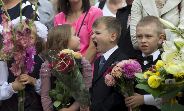 Children, going to the first grade, line up during an event to mark the upcoming start of another school year in Minsk, Belarus, August 31, 2015. (Photo by Vasily Fedosenko/Reuters)