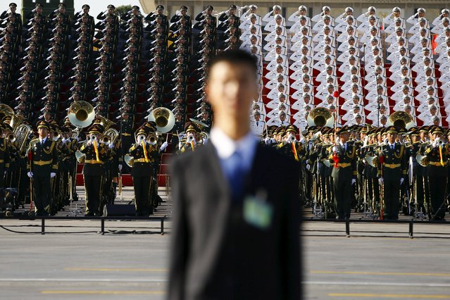 A military band plays at the Tiananmen Square before a military parade to mark the 70th anniversary of the end of World War Two, in Beijing, China, September 3, 2015. (Photo by Damir Sagolj/Reuters)
