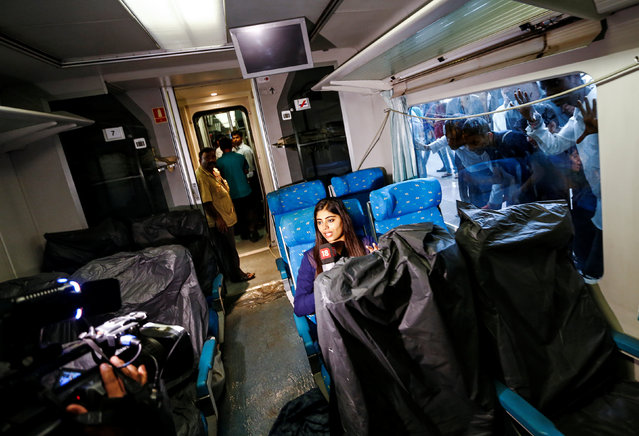 A television journalist reports from inside the parked high speed Talgo train during its trial run at a railway station in Mumbai, India August 2, 2016. (Photo by Danish Ismail/Reuters)
