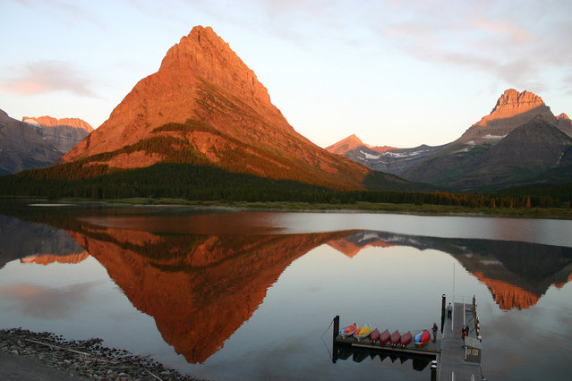 Sunrise in Glacier: I took this from the balcony of Many Glacier Lodge in Glacier National Park, on August 1, 2012. The sun was rising behind me and onto the mountains. (Photo by Sharon Lyon/National Geographic Photo Contest