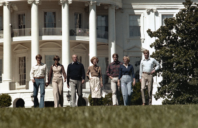 The Ford family walks outside the White House, September 9, 1976. From left to right: John Gardner Ford, unidentified, President Gerald Ford, first lady Betty Ford, Michael Gerald Ford, Susan Ford, and Steven Meigs Ford. (Photo by AP Photo)