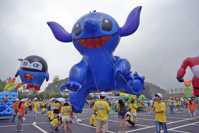 Over 11 huge parade balloons show on Chongqing Heishangu International Huge Balloon Festival in Chongqing, China on August 6, 2016. (Photo by Ran Wen/ZUMA Press/Splash News)