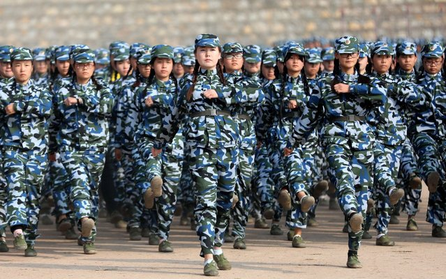 More than 500 freshman students attend the parade after the military training at Huaibei Normal University in Huaibei, east China's Anhui Province on October 20, 2017. (Photo by Sipa Asia/Rex Features/Shutterstock)