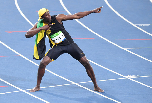 Usain Bolt (JAM) wins the 100m dash  out of lane 6 with Justin Gatlin (bringing home Silver during the Olympic Games on August 14, 2016 in Rio De Janeiro, Brazil. (Photo by Jonathan Newton/The Washington Post)