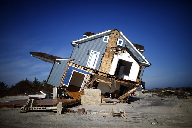 A home that was damaged by Hurricane Sandy is seen in Mantoloking, New Jersey November 12, 2012. (Photo by Eric Thayer/Reuters)