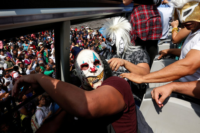 A Mexican wrestler known as Monster sits with other wrestlers in a bus during their annual pilgrimage to the Basilica of Our Lady Guadalupe in Mexico City, Mexico August 25, 2016. (Photo by Carlos Jasso/Reuters)