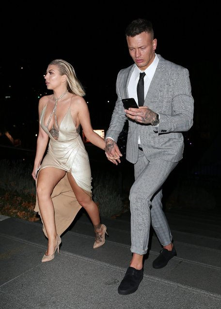 Olivia Buckland left with her man Alex Bowen attend The Beauty Awards with OK! in London, England on November 28, 2017. (Photo by Flynet Pictures)