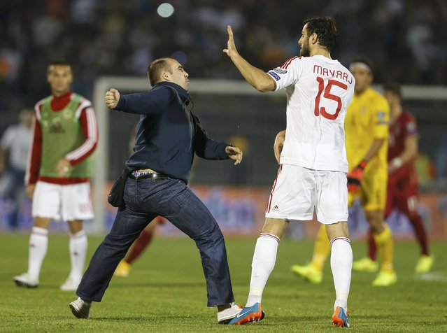 A fan of Serbia scuffles with Albania's Mergim Mavraj during their Euro 2016 Group I qualifying soccer match at the FK Partizan stadium in Belgrade October 14, 2014. The Euro 2016 qualifier between Serbia and Albania was abandoned on Tuesday following a brawl between players from both sides. (Photo by Marko Djurica/Reuters)